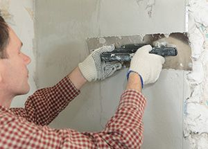 Barons Court plastering services W14